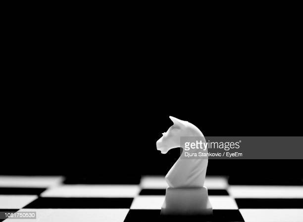 close-up of chess pieces against black background - chess board stock pictures, royalty-free photos & images