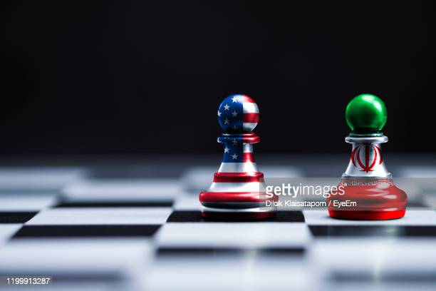 close-up of chess pieces against black background - iran stock pictures, royalty-free photos & images