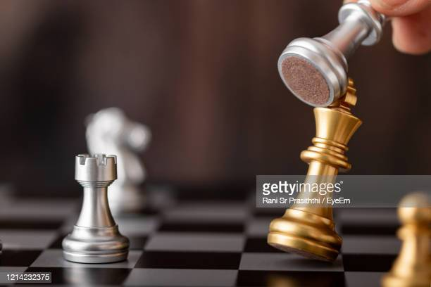 close-up of chess pieces against blurred background - military attack stock pictures, royalty-free photos & images