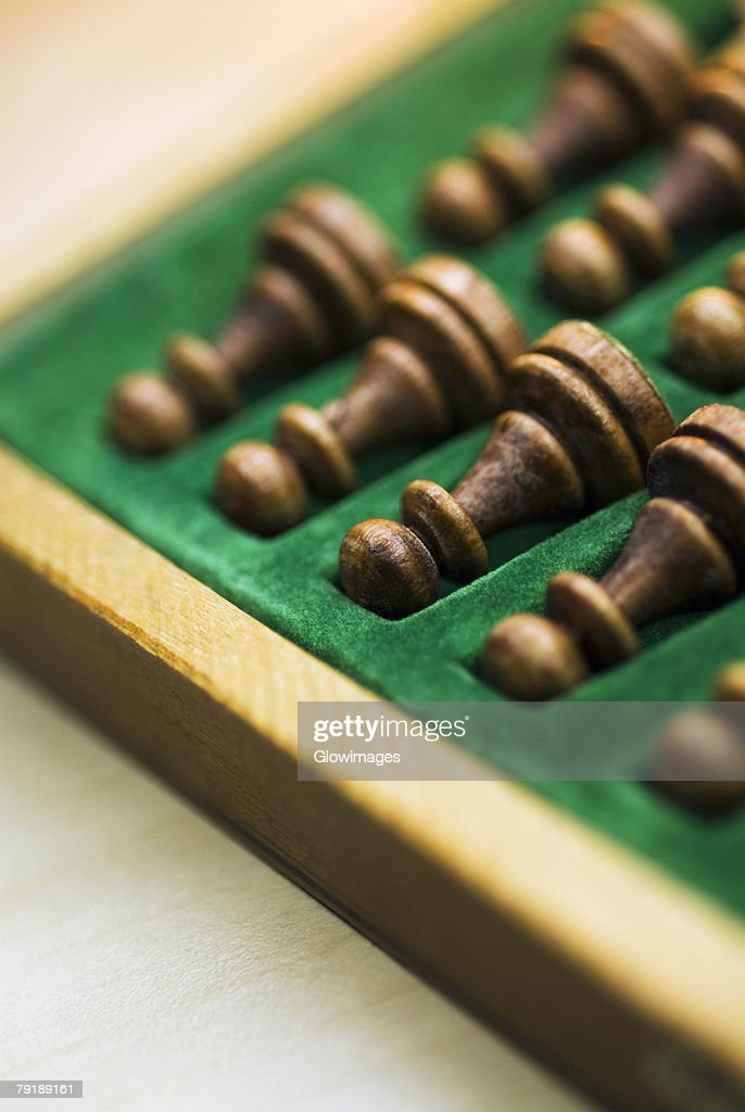 Close-up of chess pieces in a wooden box : Stock Photo