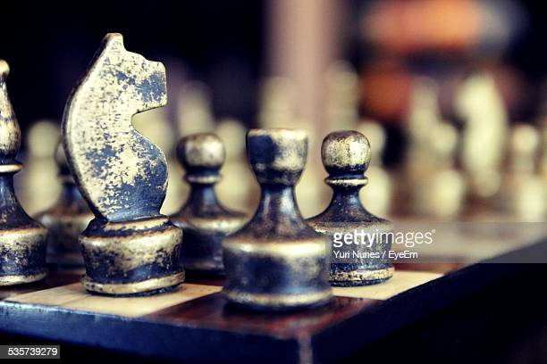 Close-Up Of Chess Pieces On Chess Board