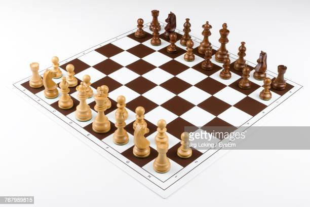 close-up of chess pieces on white background - chess board stock pictures, royalty-free photos & images