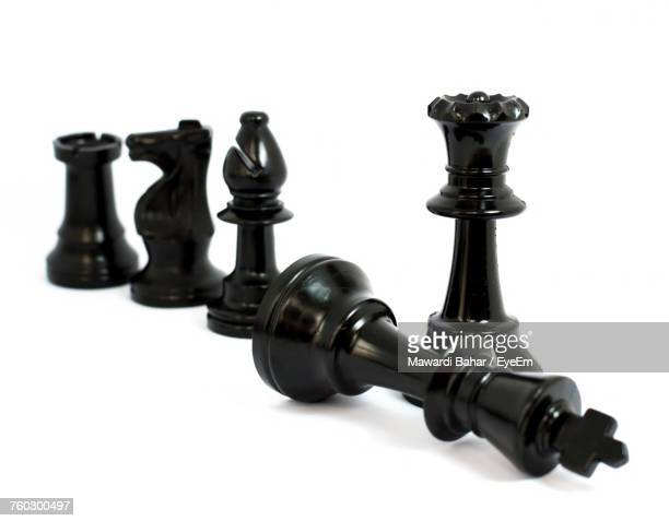Close-Up Of Chess Pieces Over White Background