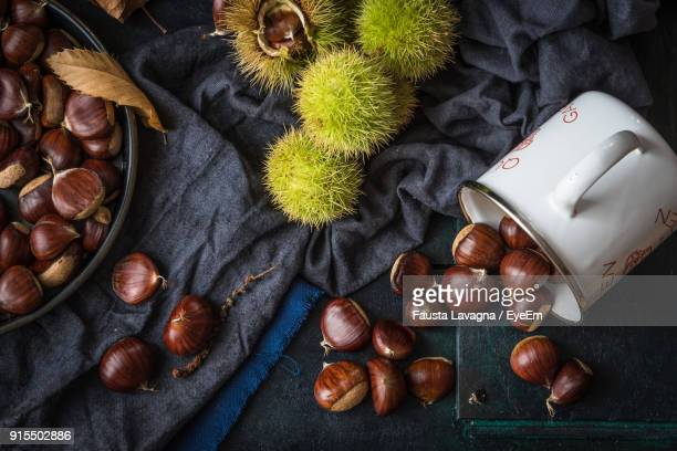 close-up of chestnuts on table - marrone foto e immagini stock