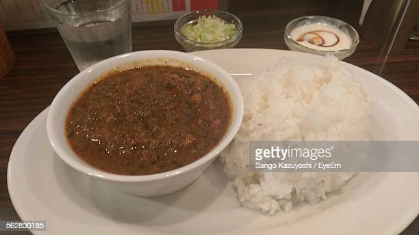 Close-Up Of Chicken Curry And Rice Served In Plate