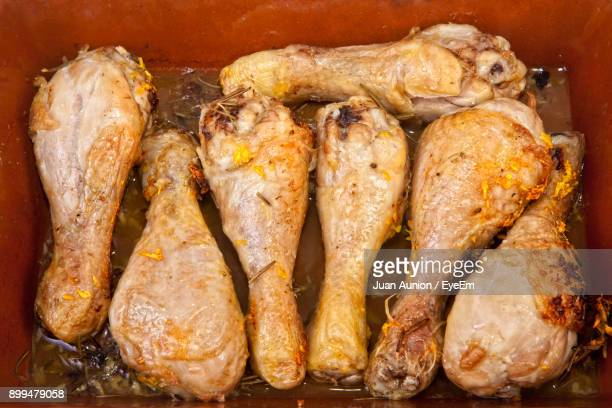 close-up of chicken meat in container - chicken leg stock photos and pictures