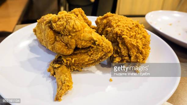 Close-Up Of Chicken Meat Served In Plate On Table At Restaurant