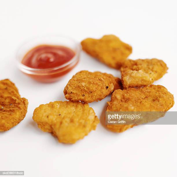 Close-up of chicken nuggets with ketchup