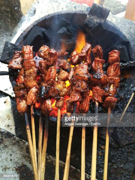 Close-Up Of Chicken Skewers On Barbecue