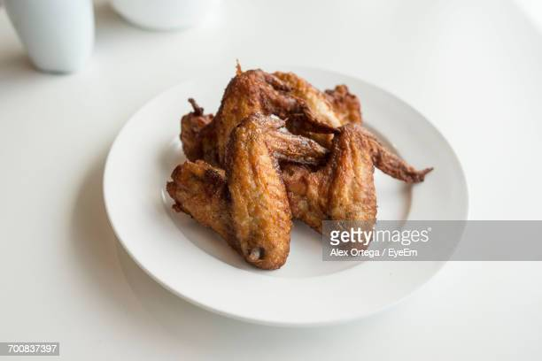 Close-Up Of Chicken Wings In Plate On Table