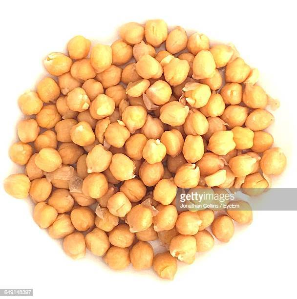 Close-Up Of Chickpeas Against White Background