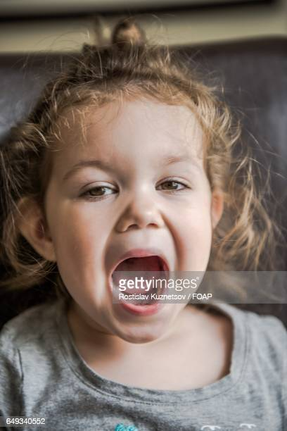 close-up of child girl with mouth open - girls open mouth stock photos and pictures