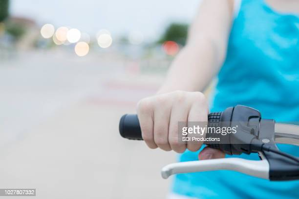closeup of child's hand holding bicycle handlebar - handlebar stock photos and pictures
