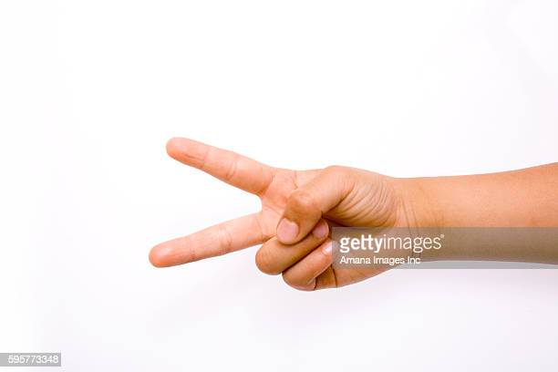 Close-up of child's hand playing Rock Paper Scissors