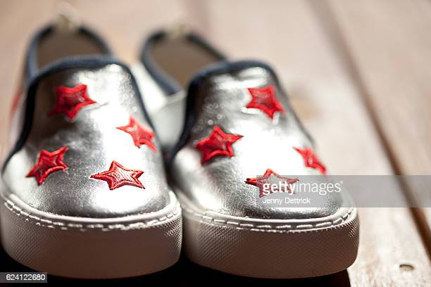 close-up of child's shoes - silver shoe stock pictures, royalty-free photos & images