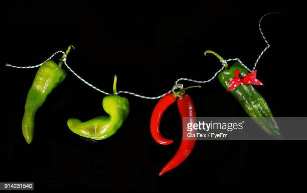 Close-Up Of Chili Pepper Against Black Background