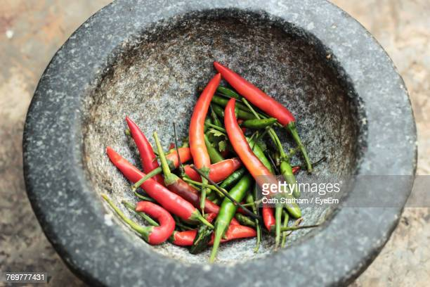 Close-Up Of Chili Peppers In Mortar