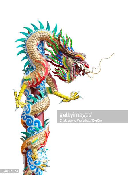 close-up of chinese dragon against white background - chinese dragon stock photos and pictures