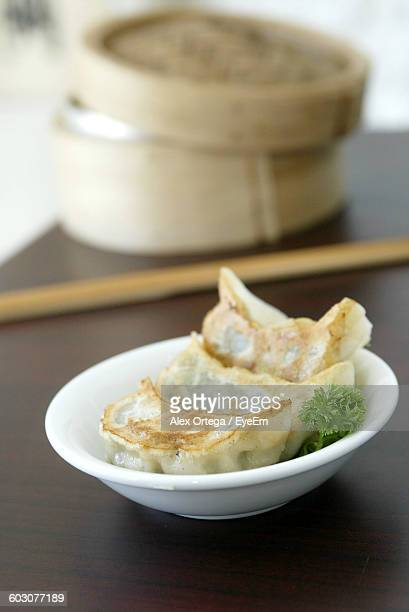 Close-Up Of Chinese Dumplings In Bowl On Restaurant Table
