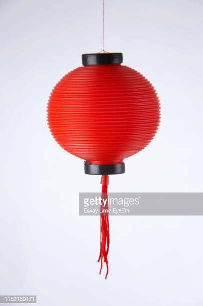 close-up of chinese lantern hanging against white background - 中国提灯 ストックフォトと画像