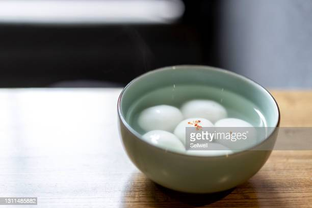 close-up of chinese traditional tangyuan on the table - chinese lantern festival stock pictures, royalty-free photos & images