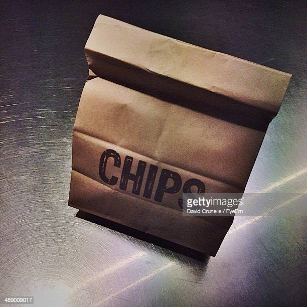 Close-up of chips in take away paper bag