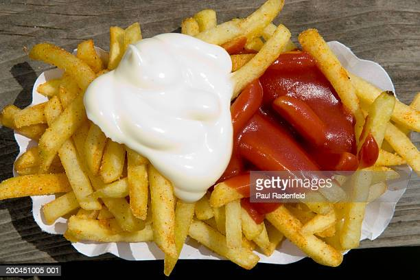 Close-up of chips with mayonnaise and ketchup