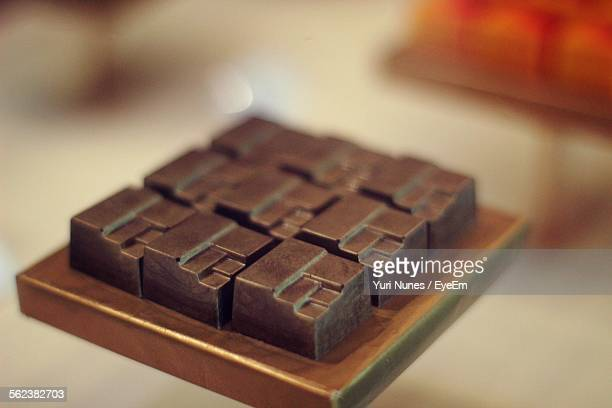 Close-Up Of Chocolate Block On Table At Shop