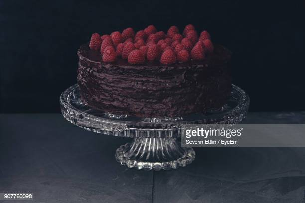 Close-Up Of Chocolate Cake On Table Against Black Background
