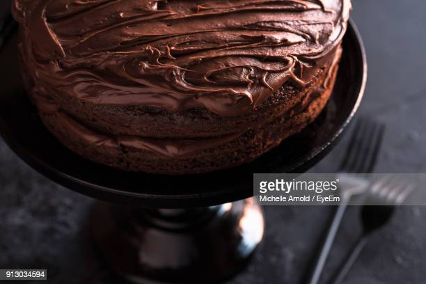 close-up of chocolate cake on table - chocolate cake above stock pictures, royalty-free photos & images