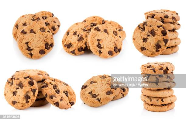 close-up of chocolate chip cookies over white background - cookie stock pictures, royalty-free photos & images