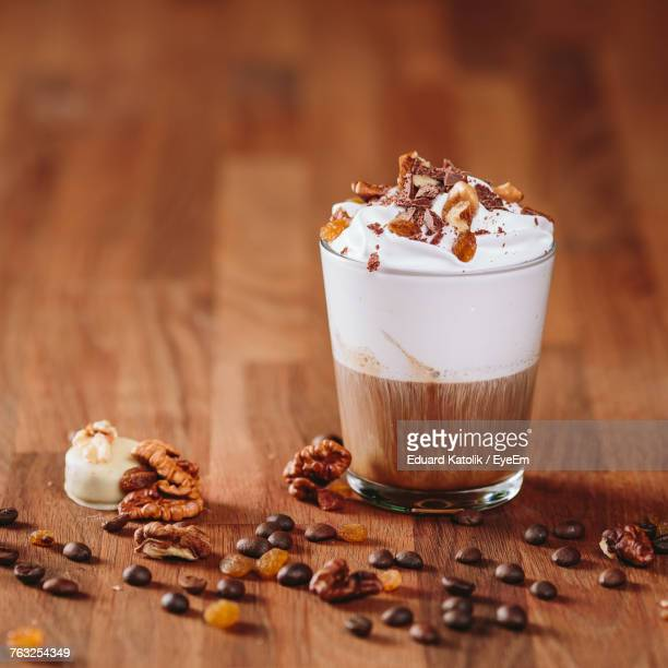 close-up of chocolate coffee on wooden table - coffee with chocolate stock pictures, royalty-free photos & images