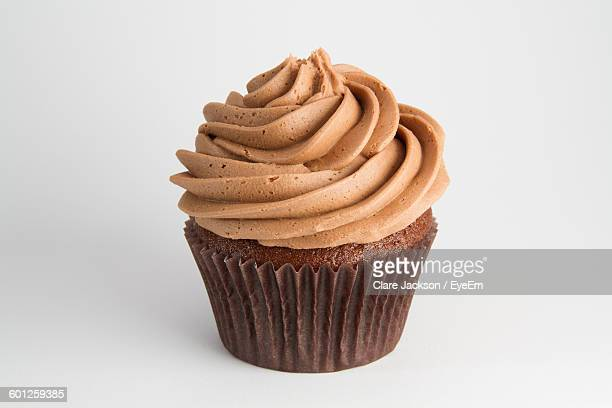 Close-Up Of Chocolate Cupcake On White Background