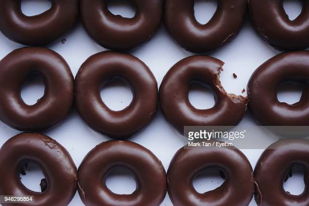close-up of chocolate donut - missing bite stock photos and pictures