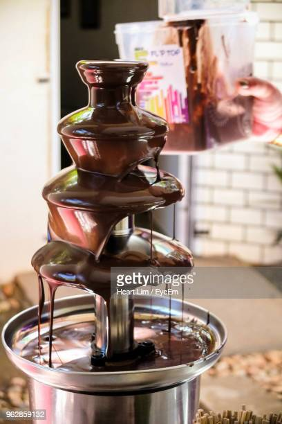 close-up of chocolate fountain - chocolate factory stock pictures, royalty-free photos & images