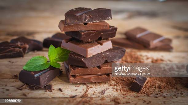 close-up of chocolate on table - chocolate bar stock pictures, royalty-free photos & images
