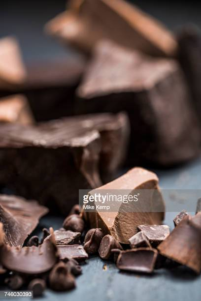 close-up of chocolate pieces - chocolate pieces stock photos and pictures