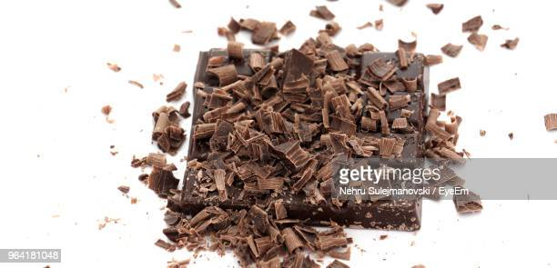 Close-Up Of Chocolate Shavings Against White Background