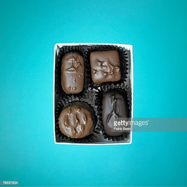 close-up of chocolates in a box - box of chocolate stock pictures, royalty-free photos & images