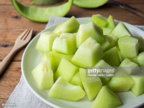 close-up of chopped melon in plate - muskmelon stock pictures, royalty-free photos & images