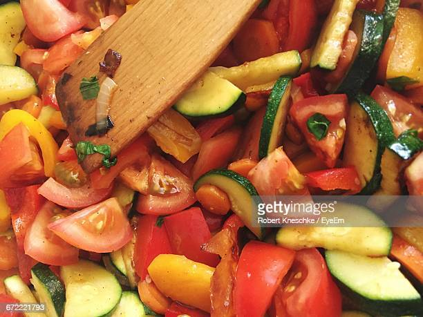 Close-Up Of Chopped Vegetables Being Cooked In Pan
