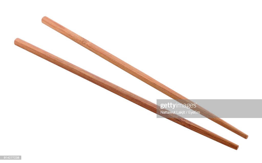 Close-Up Of Chopsticks Against White Background : Stock Photo