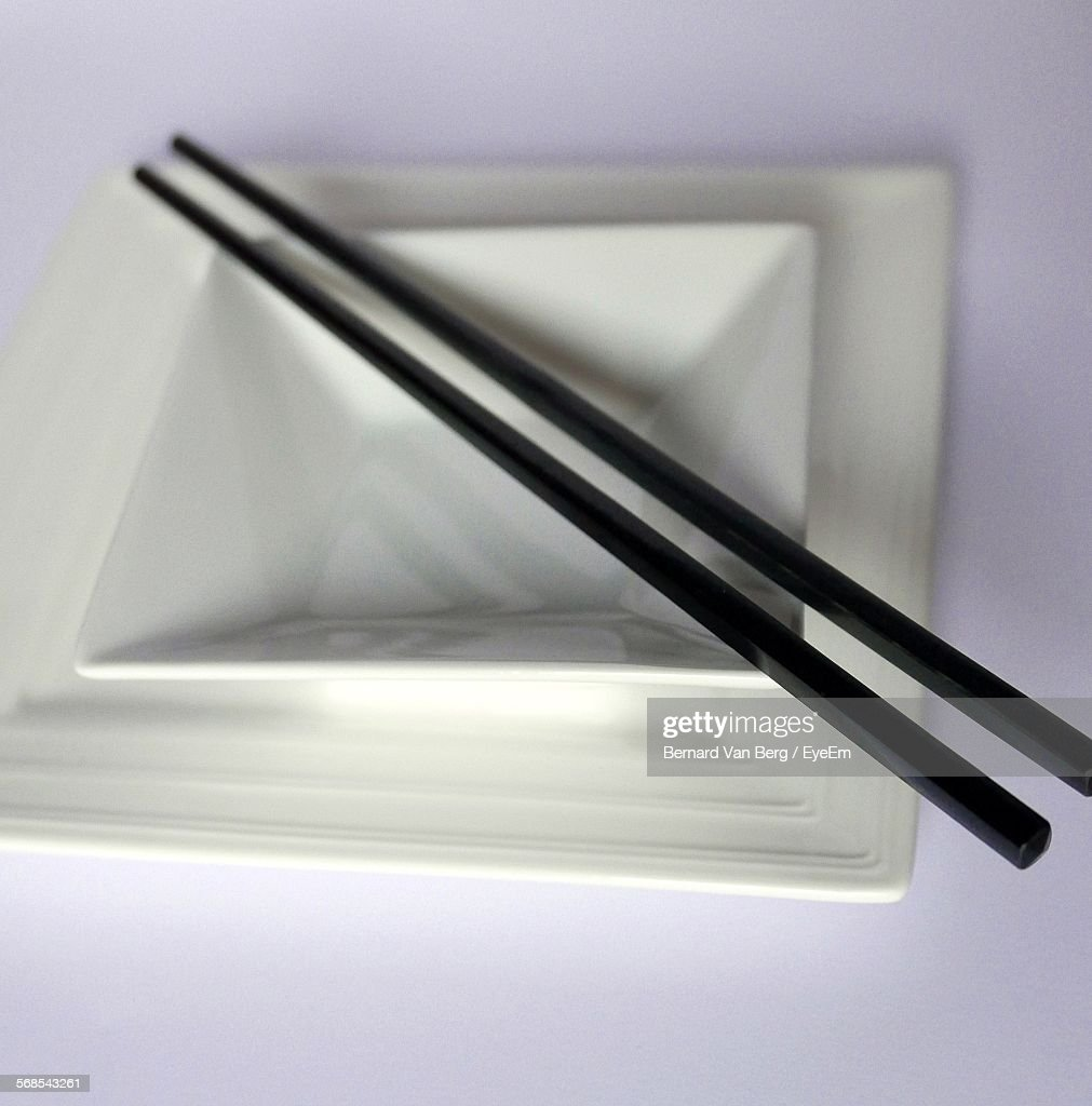 Close-Up Of Chopsticks And Bowl On Table : Stock Photo
