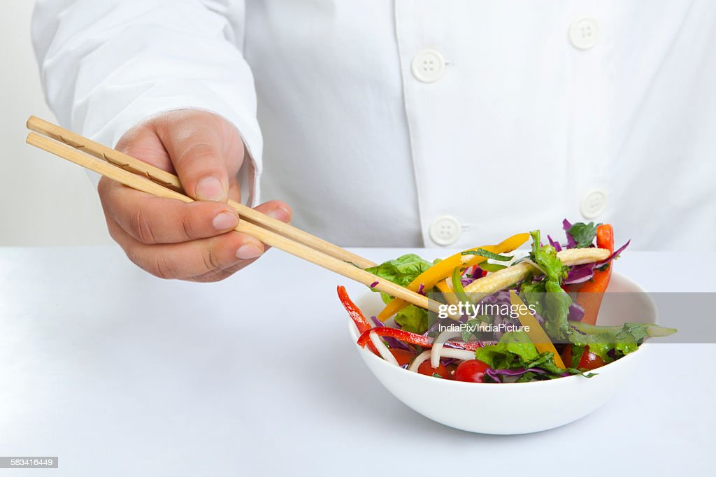 Close-up of chopsticks in bowl : Stock Photo