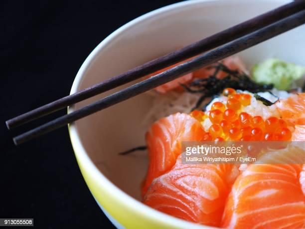 Close-Up Of Chopsticks Over Sushi In Bowl