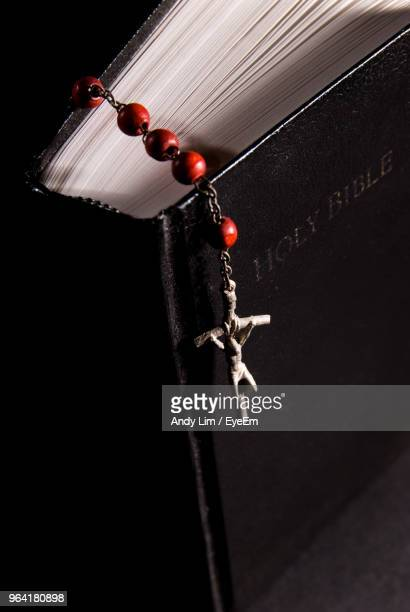 Close-Up Of Christian Cross On Bible