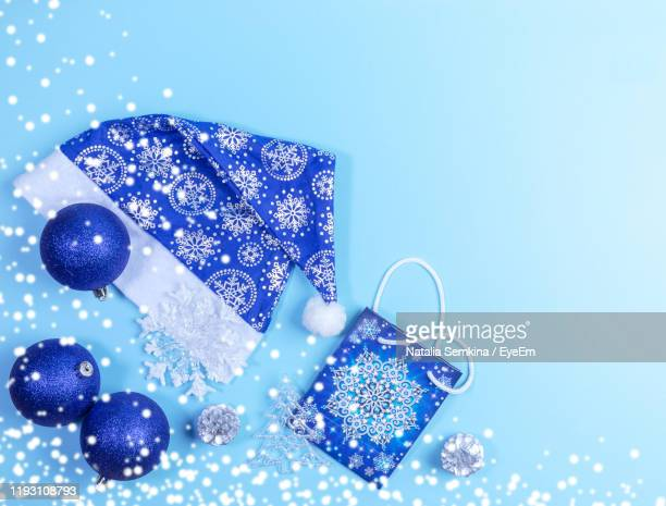 close-up of christmas decoration against blue background - purple hat stock pictures, royalty-free photos & images