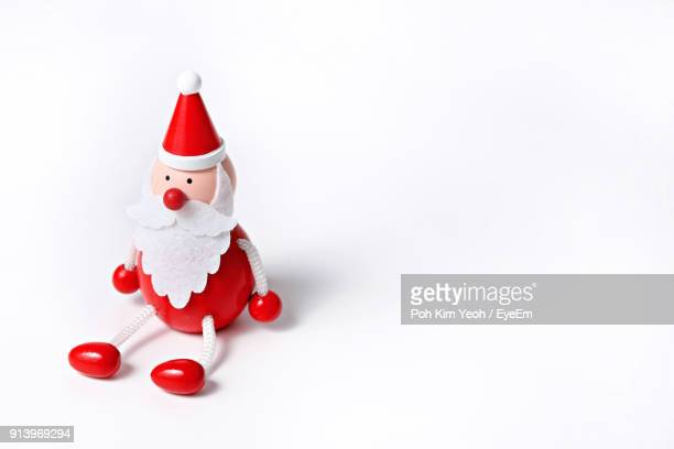 close-up of christmas decoration against white background - santa close up stock pictures, royalty-free photos & images