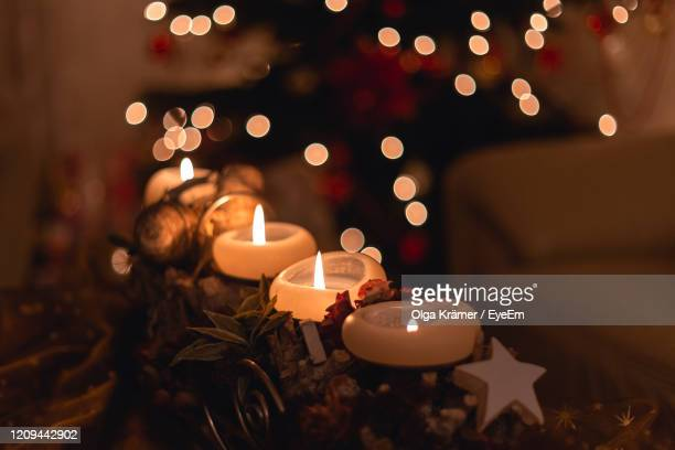 close-up of christmas decoration at home - christmas decore candle stock pictures, royalty-free photos & images