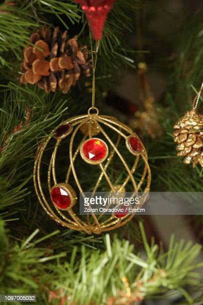 Close-Up Of Christmas Decoration Hanging From Tree